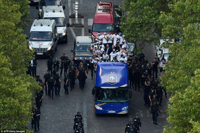 The French football team happily celebrated on the roof of the bus as they made their way towards a triumphant parade this evening