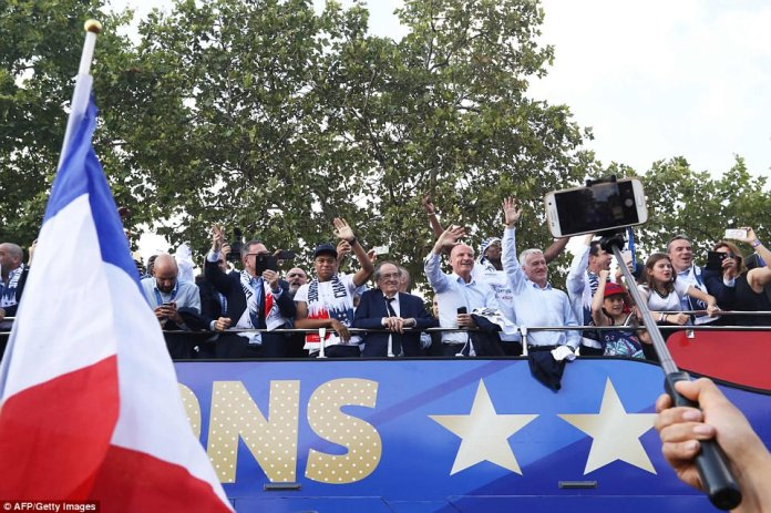 France's forward Kylian Mbappe (left), French Football Federation president Noel Le Graet (second left), France's assistant coach Guy Stephan (second right) and France's coach Didier Deschamps (right) were all seen partying on the bus