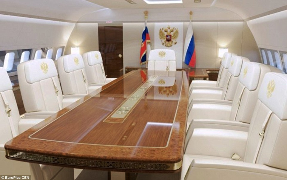 Russia's leader can consult with his senior staff on board the jet in this swanky conference-style meeting room