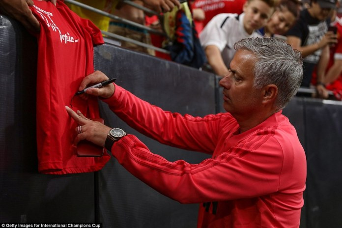 Manchester United manager Jose Mourinho signs an autograph for some of the many fans prior to kick-off in Arizona