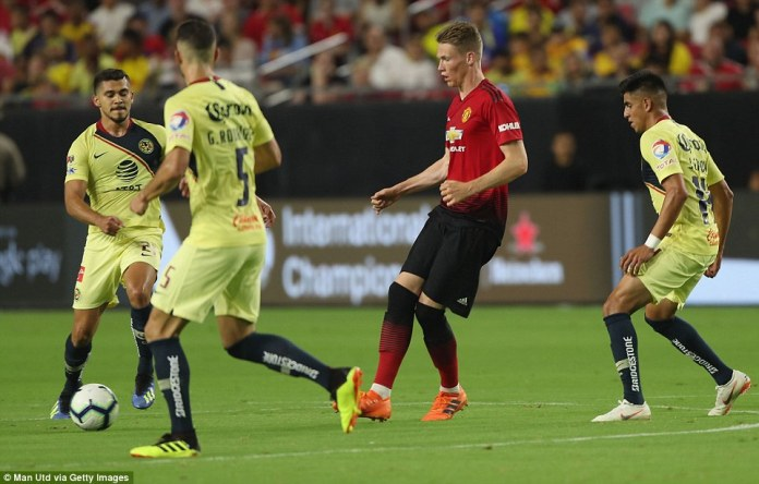 Scott McTominay manages to offload a pass despite a lot of pressure from the opposition