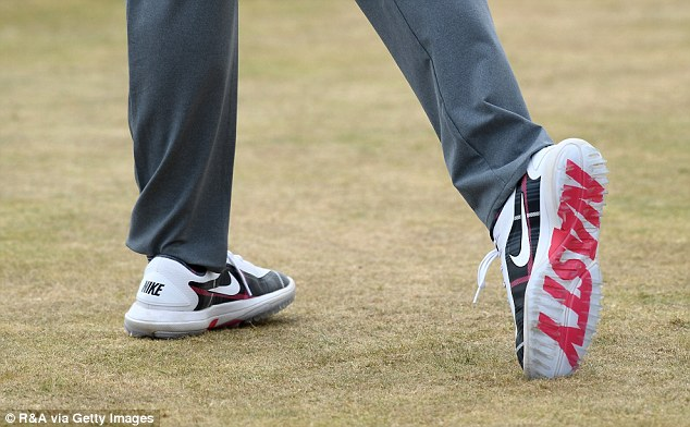 McIlroy caught the eye with the word 'nasty' emblazoned across the sole of his shoe