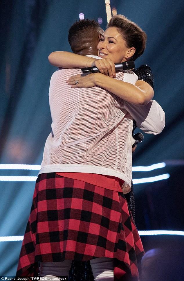 Aww! Emma gave Kori a warm hug after an incredible performance