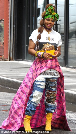 She added a graphic tee and  distressed blue jeans tucked into  yellow ankle boots