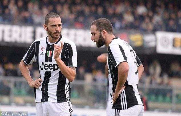 Bonucci (left) swapped Juve for Milan last summer but is open to a return to Turin