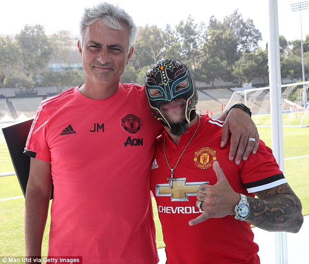 While he was not presented with his own mask, boss Jose Mourinho posed alongside Mysterio