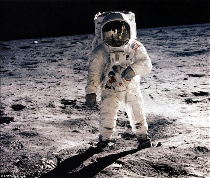 Edwin E. Aldrin Jr., lunar module pilot, walking on the surface of the moon during the Apollo 11 extravehicular activity (EVA). Astronaut Neil A. Armstrong took this photograph with a 70mm lunar surface camera. With one small step off a ladder, commander of the Apollo 11 mission Neil Armstrong of the US became the first human to set foot on the moon on July 20, 1969, before the eyes of hundreds of millions of awed television viewers worldwide.