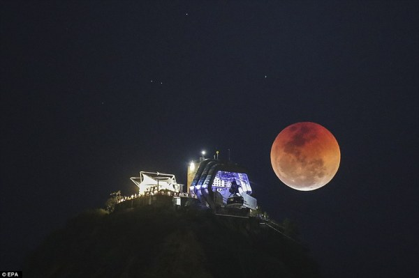 Parts of South America were able to see the crimson moon during the lunar eclipse: Pictured: Rio de Janeiro, Brazil