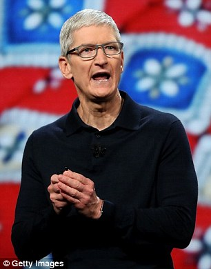Apple, headed by Tim Cook (pictured), and Amazon are leading the race to become the world's first trillion dollar company, according to new figures