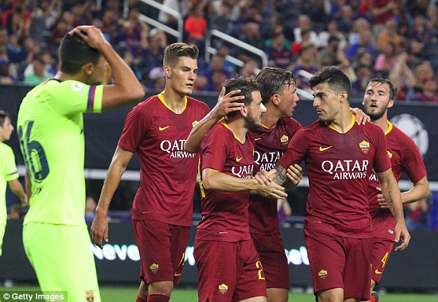 The Roma players celebrate Alessandro Florenzi's goal which brought the Italians level