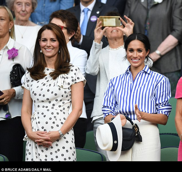 The Duchess of Cambridge, pictured at Wimbledon with Meghan on 14th July 2018, is said to be sympathetic to Meghan's family dramas and has been a 'pillar of support' to the new royal