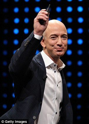 Bezos promises the heavy launch vehicle will be able to haul satellites and, eventually, people into orbit