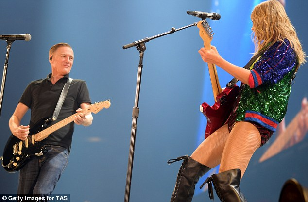 Taylor Swift and Bryan Adams rocking it out to