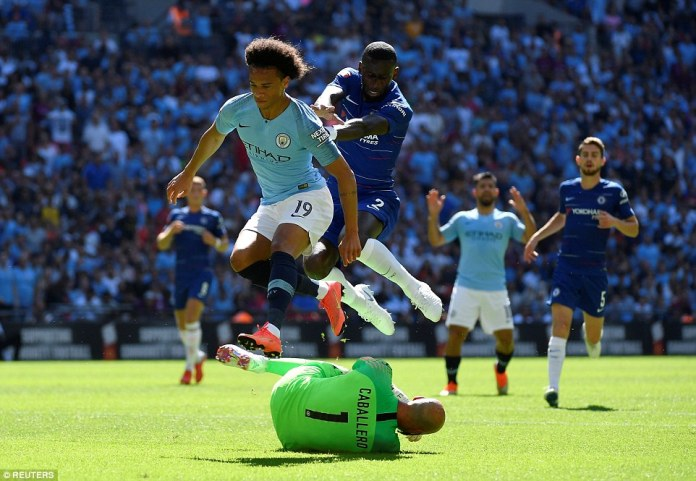 Chelsea's Willy Caballero comes out to claim the ball from City's forward Leroy Sane under pressure from Antonio Rudiger