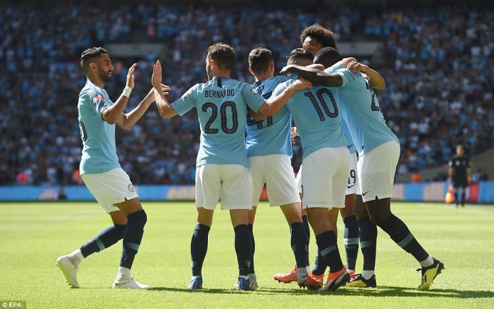 City celebrates scoring their first goal of the domestic campaign as club record scorer Aguero reached 200 goals