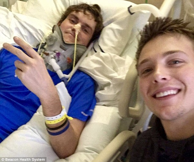 In January, Meister was being driven home from a dinner when the vehicle hit a patch of black ice. Pictured: Meister, left, with a friend in the hospital