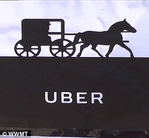 Hochstedler¿s buggy is adorned with two signs to let potential riders know about the service: one bearing the recognizable Uber logo with a picture of a horse and buggy above it, and a handwritten note touting the $5 horse-drawn buggy rides