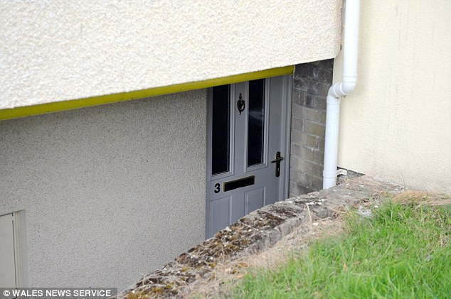 Three men have been arrested after the murder, which took place at Gaut's basement flat (pictured today)