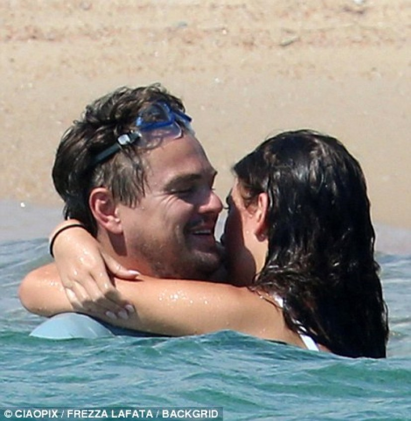 Rare display of public affection: The Wolf Of Wall Street actor passionately gathered a bikini-clad Camila in his arms during their amorous clinch