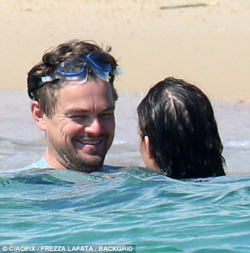 Making a splash:The couple seemed to be in great spirits as they laughed and chatted away happily during their cooling dip in the azure-blue seas