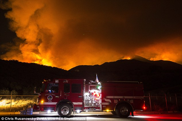 Authorities said the fire destroyed all the cabins - except Clark's - in theHoly Jim Canyon area