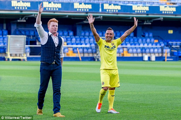 Santi Cazorla waves to Villarreal fans after being bizarrely presented in a plume of smoke
