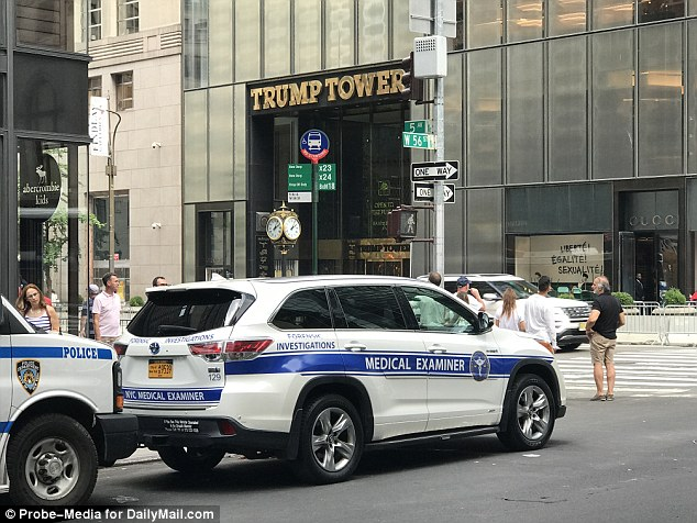 The medical examiner's car remained outside Trump Tower on Friday afternoon hours after the 51-year-old died reportedly after trying taking Narcan to reverse the effects of opioids