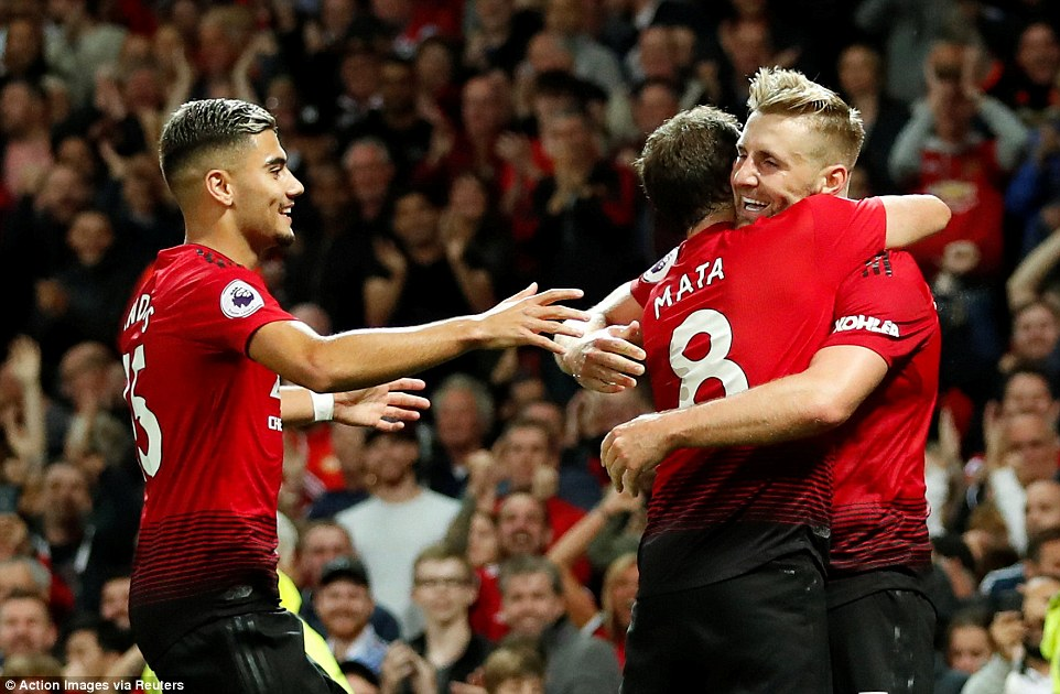 Shaw - who has previously been a magnet for criticism at United - is embraced after scoring what proved the winning goal