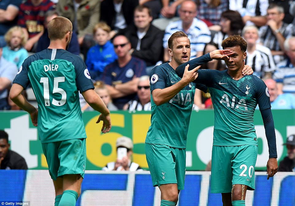 Alli celebrates restoring Tottenham's lead in the 18th minute with team-mates Harry Kane and Eric Dier on Saturday