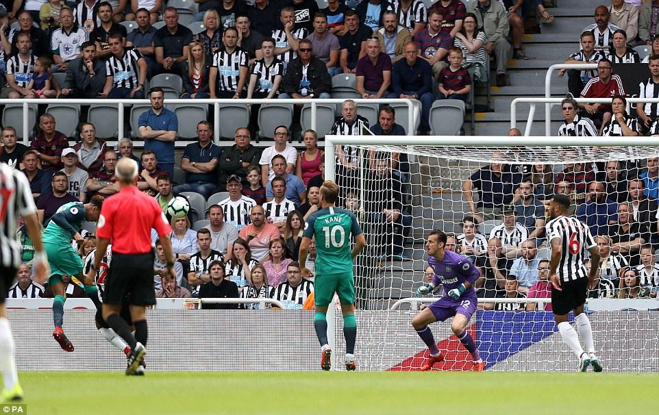 Tottenham's Dele Alli (left) scores his side's second goal of the game during the Premier League match at St James' Park
