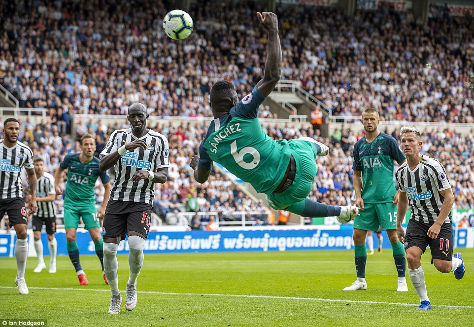 Spurs' Davinson Sanchez is not able to get over the ball and fires his effort on goal over the bar in the second half of the match