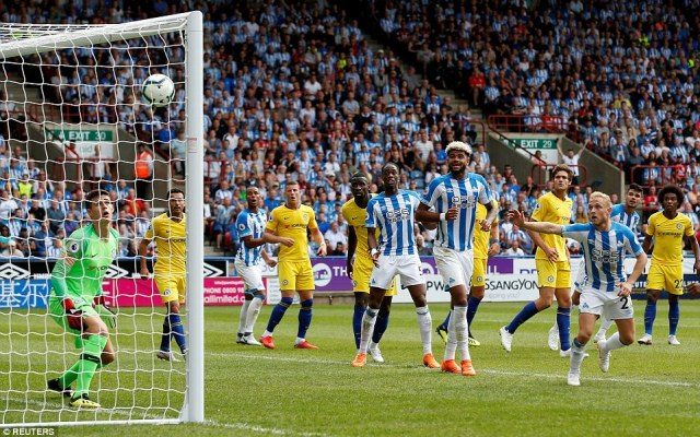 Huddersfield's Steve Mounie almost got them back on level terms but his header struck the inside the post and came out