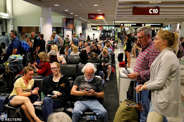 Images from the airport terminal showed hundreds of Air Alaska Airlines passengers queuing with their baggage and awaiting information