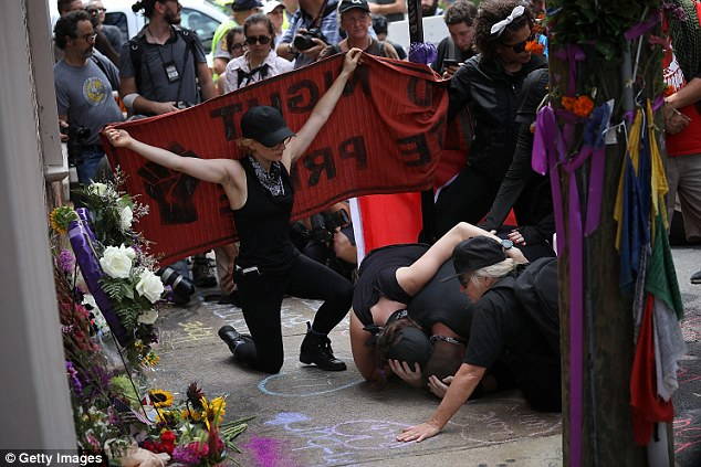 Antifa protesters visited her memorial, sobbing on the ground and clutching onto each other