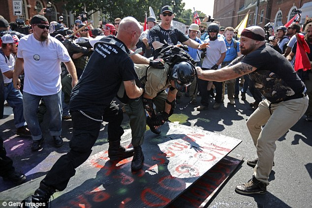 White nationalists, neo-Nazis,  KKK members, and the alt-right attacked each other as counter protesters intervened outside Emancipation Park in Charlottesville last year on August 12