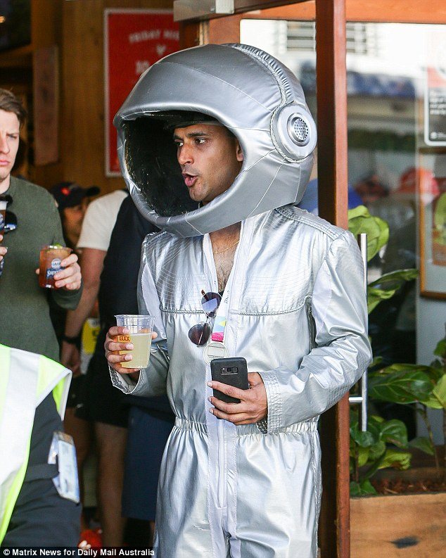 One patron proudly showed off his medal, accompanied by a head-to-toe space suit and a beverage