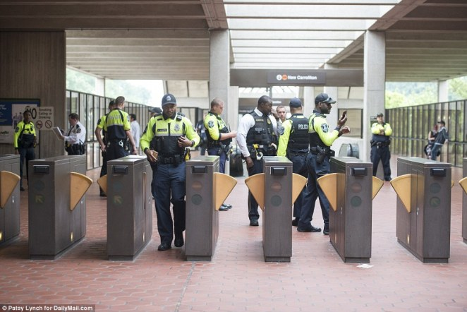 Kessler, who abandoned his bid to stage a similar anniversary event in Charlottesville, told local news outlets that Unite the Rite 2 demonstrators are there to 'stand up for free speech, which has really been in danger over the last year since Charlottesville'. Officers are seen blocking off the entrance of the Vienna Metro station in DC
