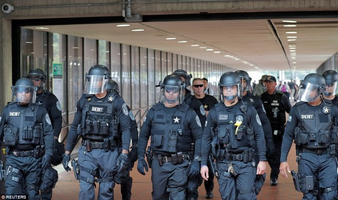 Police officers arrived to the Vienna Metro Station with their riot gear ahead of the protests on Sunday