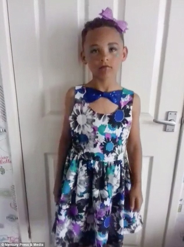 Eight-year-old Fabian Butler, from Gwent, dressing up at home. The youngster loves wearing women's clothes and has no problem in hitting back at bullies, saying: 'I'm not gay'