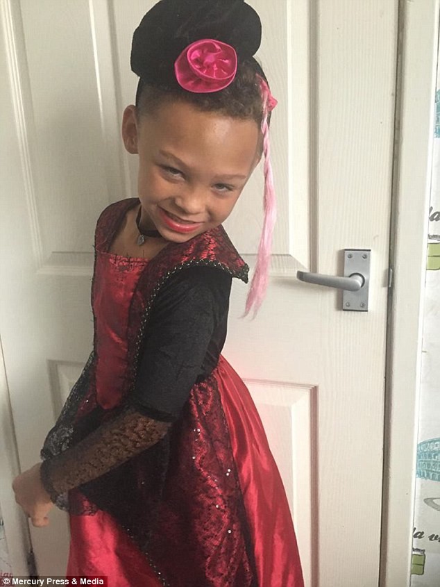 In character: Fabian Butler, eight, loves dressing up as his drag queen alter ego Francesca (pictured at home in Gwent) and spends hours getting dressed up in women's clothing