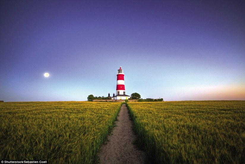 Happisburgh Lighthouse in Norfolk has been warning shipping about coastal sandbanks since 1790. Officially declared redundant in 1988, it has operated under local management since 1990. It is the only independently run coastal lighthouse in the UK. The double red-banded tower is 85ft high, with a triple white flash every 30 seconds