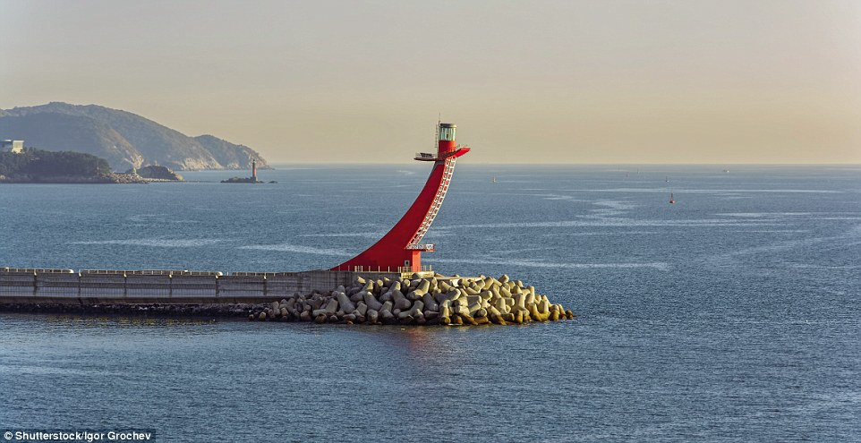With a focal height of 125ft, the Gadeokdo East Breakwater Lighthouse in South Korea is built of concrete and sweeps up in a quarter-circle arc like the prow of a ship. Painted red, it stands at the west end of a detached breakwater. Its light is also red, flashing every four seconds