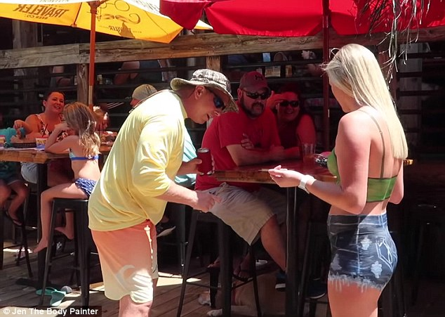 Close encounter: 'That's awesome,' one man said as he leaned forward to check out her painted shorts