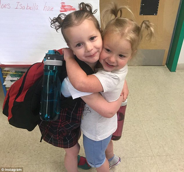 Celeste, three, and Bella, four are seen together in May. Police say the girls were killed in their house along with their mother, and the bodies were moved to an oil field