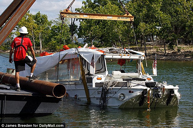 Gregory Harris filed a lawsuit on Wednesday against a Missouri duck boat company because he claims he was injured and suffers PTSD after helping to rescue the drowning victims when the vessel (above) sank last month