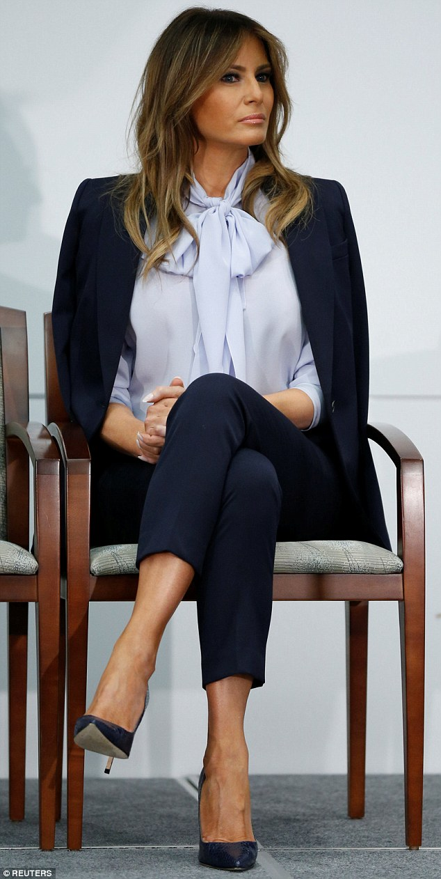 Outfit: Melania Trump took to the stage in a pussy bow blouse and a pantsuit as she spoke during a conference on cyberbullying on Monday