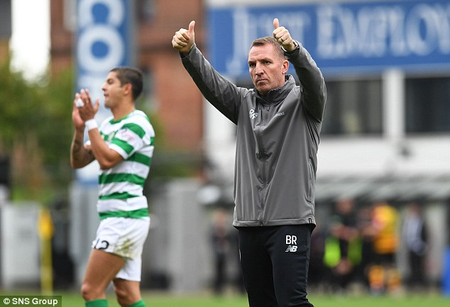 Brendan Rodgers gives thumbs up to the Celtic fans after victory over Partick Thistle