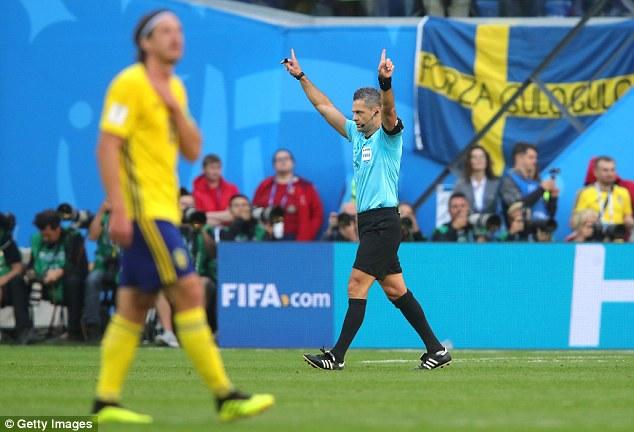 Referee Damir Skomina (right) gives VAR signal during Sweden v Switzerland in round of 16