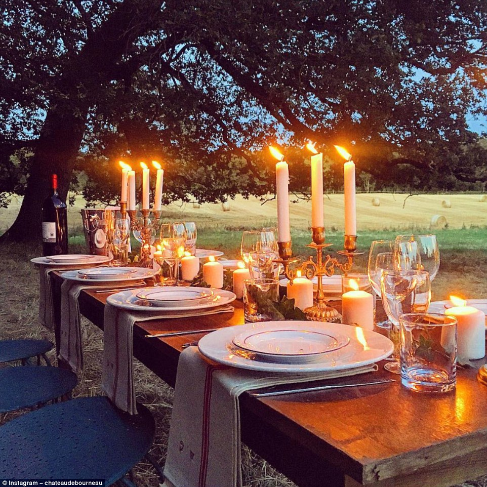 'Excited for the arrival of our guests': A dinner table in the ruined orangery is ready for summer fresco dining. The fairytale Château de Bourneau in Vendee, Pays de la Loire was recently purchased by Jean-Baptiste Gois and Erin. The doctor, who did not reveal how much the château cost, is originally from London but met her partner in Edinburgh in 2010