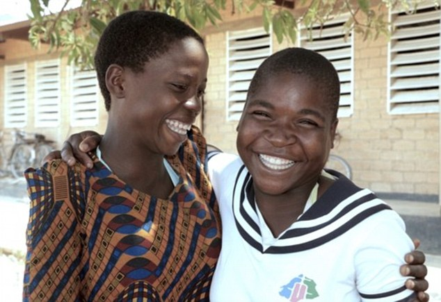 Nelly (right) has returned to a friendly environment at school after her horrific ordeal that saw her being forced into a child marriage, later escaping to return to her family